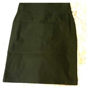 Size M/L. Knee length pencil skirt with back bow.